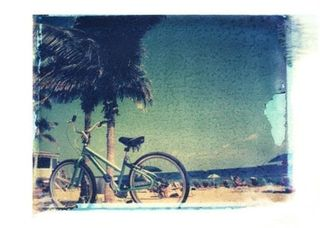 Polaroid transfer of beach bicycle-shehitpausestudios.etsy